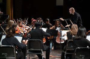 conductor in concert with youth orchestra